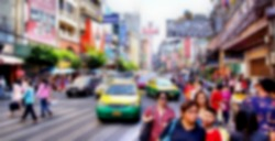 blurred image from a big city with shopping people