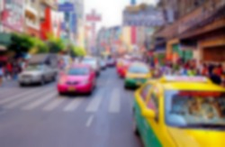 blurred image from a street in a big city filled with cars and cabs