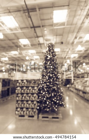 blurred image huge christmas tree decoration in wholesale store wreaths and strings of bokeh light - Wholesale Vintage Christmas Decorations