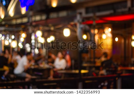 blurred image Lots of people enjoy at the bar pub fun of night festival in a restaurant and The atmosphere is party happy and relaxing.