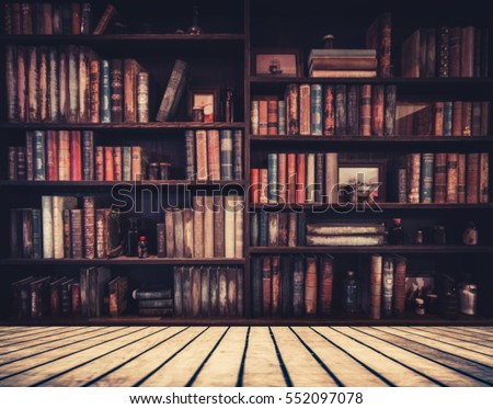 Shutterstock blurred Image many old books on bookshelf in library