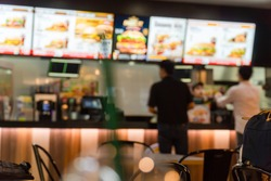 Blurred image of a fast food restaurant, also known as a quick service restaurant within the airport.