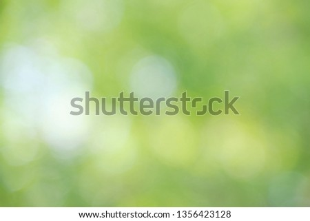 Blurred image of abstract circular green Bokeh from nature background, soft and blur focus.using as background or wallpaper #1356423128
