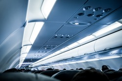 Blurred image of airplane interior in blue color filter