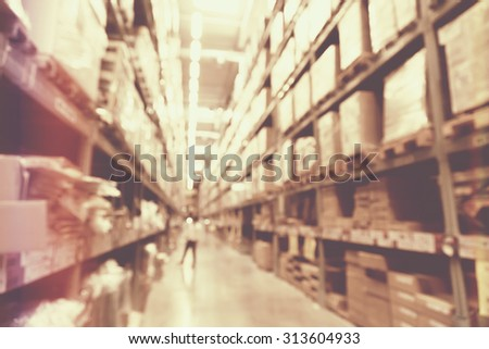 blurred image of boxes in factory warehouse with light leak filter.