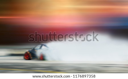 Blurred image of car drifting on track with grain, Sport car wheel drifting and smoking on track.