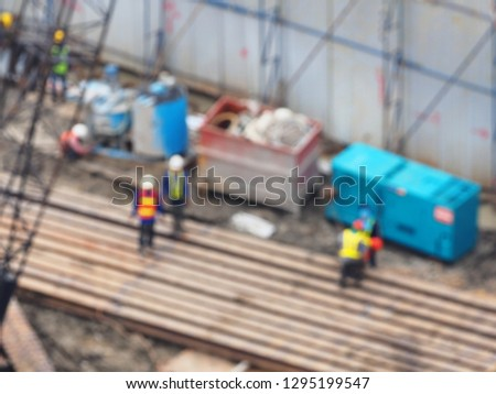Blurred image of construction of the new building, Images blur and out focus of Workers are working on piling bored piles to make foundations.construction concept