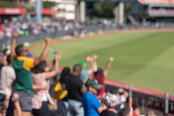 Blurred image of cricket supporters celebrating