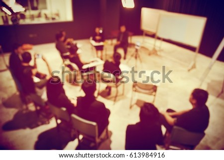 blurred image of group Business team People in black shirt Colleagues Teamwork sitting and stand, Meeting for planning project business in studio  Concept. vintage filter. #613984916