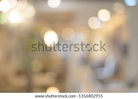 Blurred image of living room with light bokeh for background,use for backdrop or web design,interior design. #1356802955