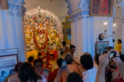 Blurred image of Male and female devotees taking pictures of Goddess Durga at Shobhabazar Rajbari , bonedi barhir pujo. Durga Puja fextival joy at mohashtami morning. Kolkata, West Bengal, India.