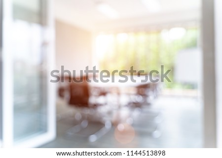 Blurred image of meeting room in the modern office, evening time with sunlight - ideal for presentation background.