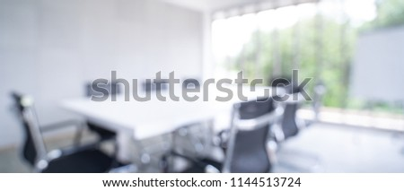 Blurred image of meeting room in the modern office - ideal for presentation background. #1144513724