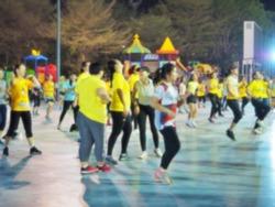 blurred image of people aerobic dance exercise at public stadium