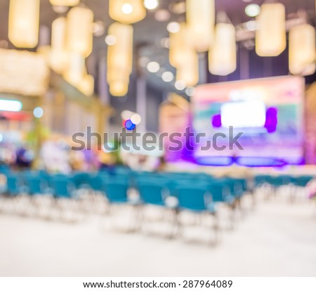 Blurred image of people in auditorium , blur background with bokeh .