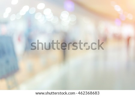 Blurred image of people in shopping mall.Vintage tone. #462368683