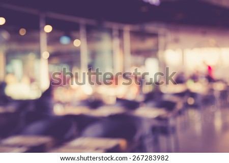 blurred image of people in...