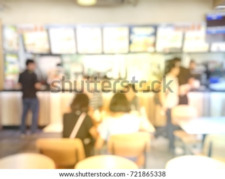 blurred image of people waiting ...