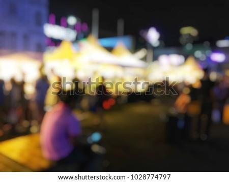 blurred image of people walking ...