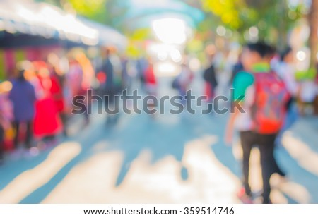 Blurred image of people walking at day market in sunny day, blur background with bokeh . #359514746