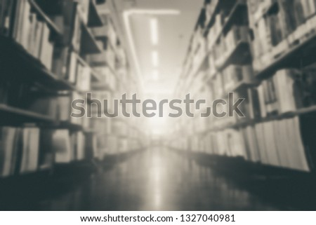 Blurred image of picture library background. Library resources, including vast knowledge and sun light. old, vintage