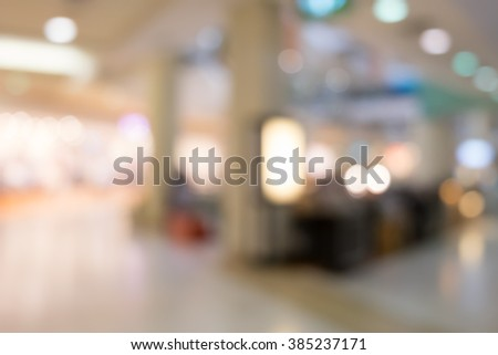blurred image of shopping mall and people #385237171