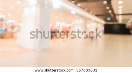 blurred image of shopping mall and people for background usage . #357683801