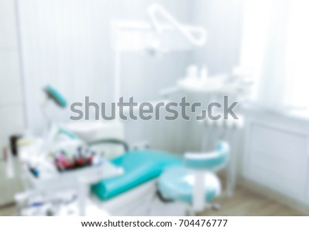 Blurred image of the dentist office, medical background. Dentist cabinet. #704476777