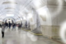 Blurred image of the metro station with people and passenger standing, walking and waiting for pick and choose the best public transport during rush hour in Moscow