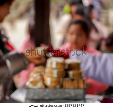 Blurred image of tourist woman buying