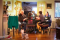 blurred image of Typical American family gathered around kitchen table