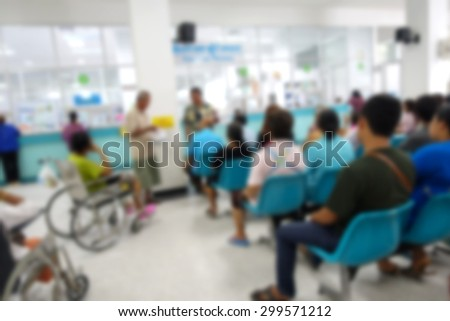 Blurred image of unidentified people and patient waiting doctor or medicine in hospital.