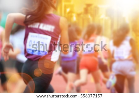 Blurred image of women marathon racing in the city with lans flare. #556077157