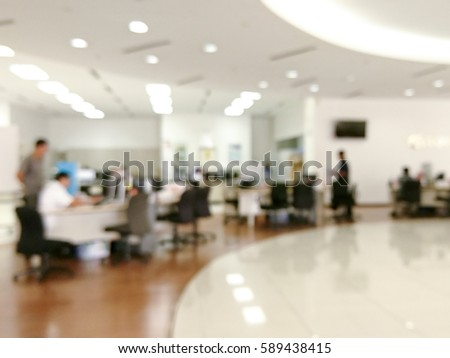 Blurred image of workers at open office environment  #589438415