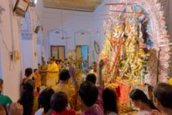 Blurred image of worshipping, flowers are thrown, prayers made and Pushpanjali being offered by Hindu devotees to Goddess Durga at Shobhabazar Rajbari , bonedi barhir Durga Puja.