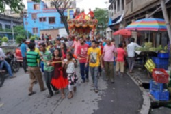 Blurred image of young Bengali Hindu devotees dragging Holy rope to pull Rath, chariot, of God Jagannath, Balaram and Goddess Suvadra as ritual , on the street. Howrah, West Bengal, India.