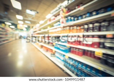 Stock Photo Blurred image soft drinks aisle in American store. The affordability, wide variety of sugary drinks contribute to the growing obesity problem in U.S. Fuzzy drink bottles on display. Vintage tone