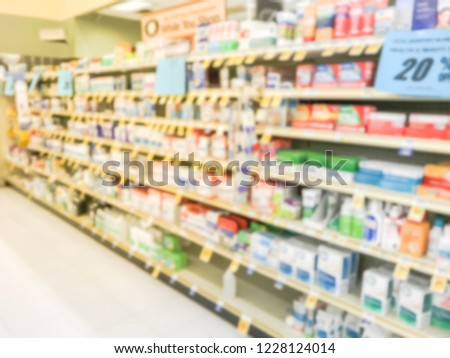 Blurred image variation of vitamin and supplement on shelves display with discounted price tags at grocery store in Texas, America.