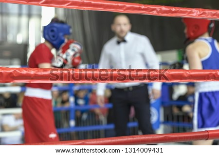 Blurred image young athletes boxers and sports referee in a ring boxing game Zdjęcia stock ©