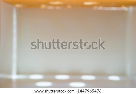 Blurred images of shining and shining beam on the background in a gray room with empty space. #1447965476