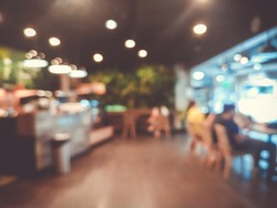 Blurred images of the coffee shop cafe interior background and lighting bokeh