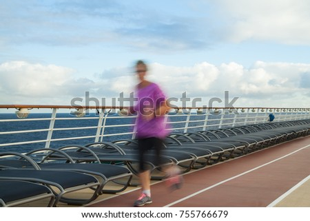 Blurred Joggers on cruise ship running track #755766679