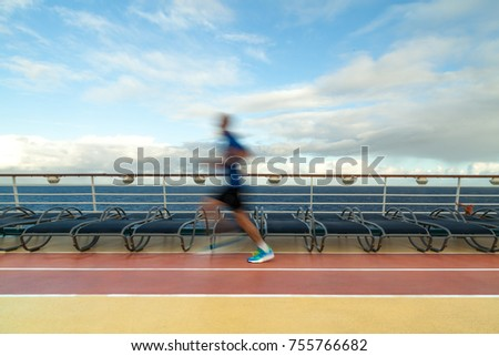 Blurred Joggers on cruise ship running track #755766682