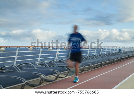 Blurred Joggers on cruise ship running track #755766685