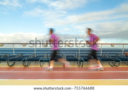 Blurred Joggers on cruise ship running track #755766688