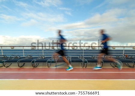 Blurred Joggers on cruise ship running track #755766691