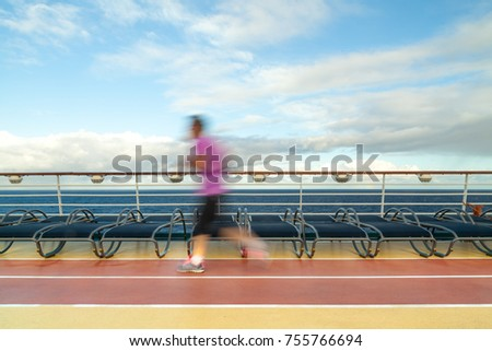 Blurred Joggers on cruise ship running track #755766694