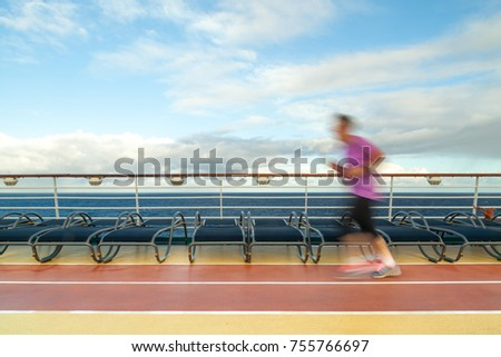 Blurred Joggers on cruise ship running track #755766697