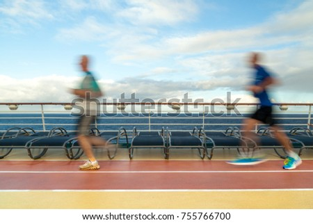Blurred Joggers on cruise ship running track #755766700