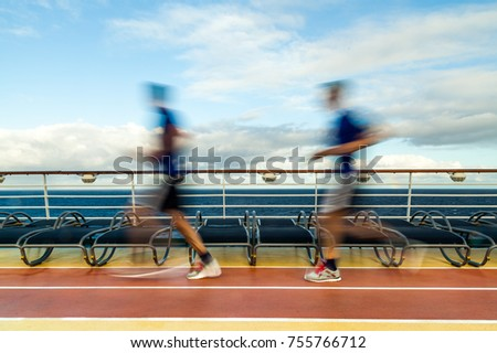 Blurred Joggers on cruise ship running track #755766712